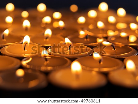 Close up view of the candles on dark background - stock photo
