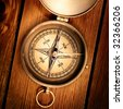 Close up view of the compass on thewood board - stock photo