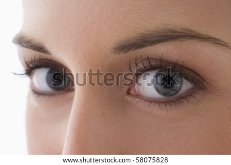 Close up view of the eyes of a young woman as she looks at the camera. Horizontal shot.