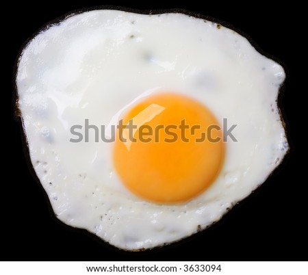 Close up view of the fried eggs on black - stock photo