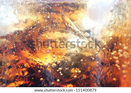 Close up view of the ice and bubble in cola background - stock photo