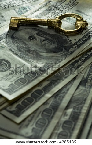Close up view of the key on money - stock photo