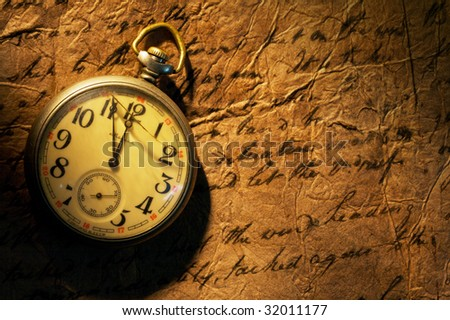Close up view of the Pocket clock on old paper - stock photo