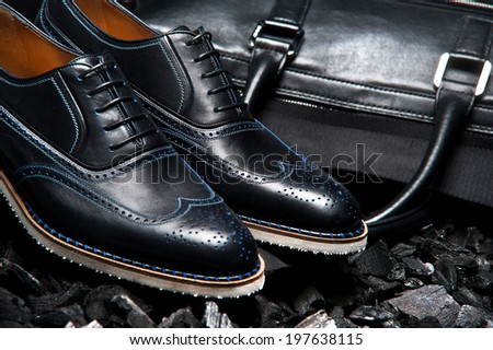 Close-up view of the stylish and elegant men's shoes and a bag for business meetings - stock photo