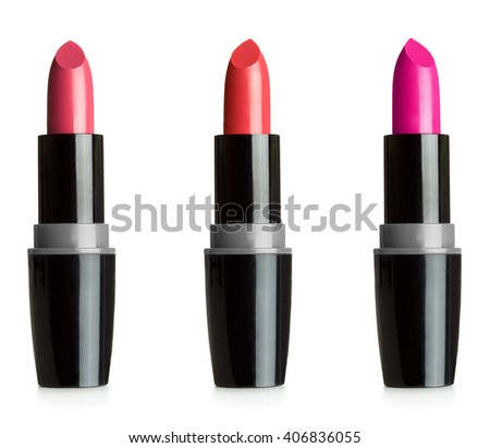 Close up view of three lipsticks isolated on white background - stock photo
