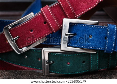 Close-up view of three suede men belts - stock photo