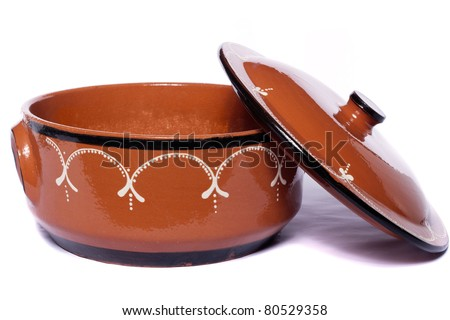 Close up view of traditional clay earthenware isolated on a white background. - stock photo