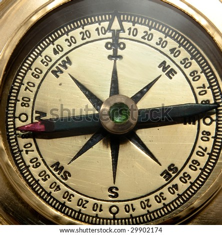 close-up view of vintage brass compass - stock photo