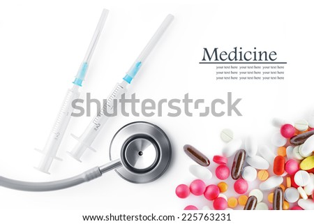 Close up view of  white plastic syringe, pills and stethoscope  on  white back - stock photo