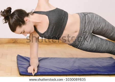 Close up view of woman doing exercise indoors. Sport concept