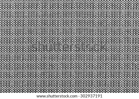 Close up view of woven tweed cloth in tones of black, white, and gray. - stock photo