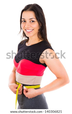 Close up view of young beautiful woman measuring her waist