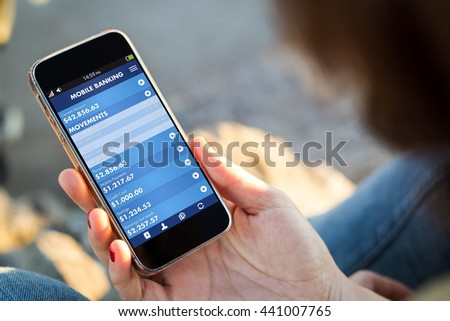 close-up view of young woman checking banking on her mobile phone. All screen graphics are made up.
