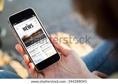 close-up view of young woman with news on screen. All screen graphics are made up. - stock photo