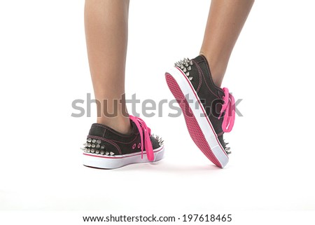 close-up View of young women  posing with new fashion shoes with studs - stock photo