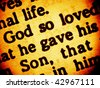 Close up view on a part of biblical text from the Bible, the Gospel of John chapter 3, verse 16, focusing on the words: God so loved - he gave his Son. (Bible in Macro series) - stock photo