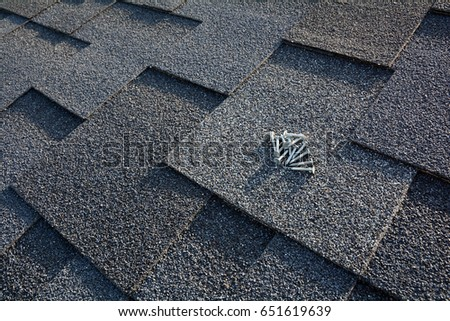 Close Up View On Asphalt Roofing Shingles Background. Roof Shingles    Roofing. Asphalt Roofing
