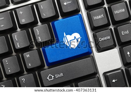 Close-up view on conceptual keyboard - Blue key with healthcare symbol - stock photo