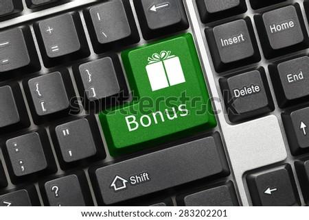 Close-up view on conceptual keyboard - Bonus (green key) - stock photo