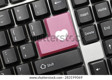 Close-up view on conceptual keyboard - Pink key with heart symbol - stock photo