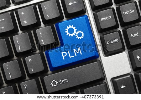 Close-up view on conceptual keyboard - PLM (blue key with gear symbol) - stock photo