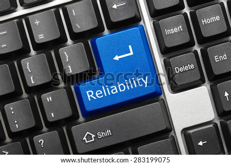 Close-up view on conceptual keyboard - Reliability (blue key) - stock photo