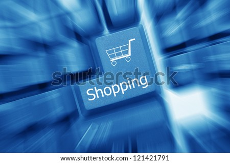 Close up view on conceptual keyboard - Shopping key (blue toned). Zoom effect - stock photo
