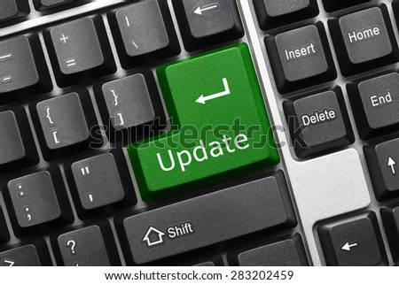 Close-up view on conceptual keyboard - Update (green key) - stock photo