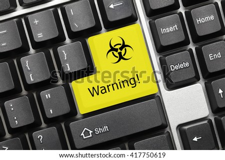 Close-up view on conceptual keyboard - Warning (yellow key with biohazard symbol) - stock photo