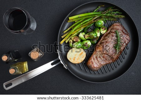 close up view on nice fresh steak on grey  background - stock photo