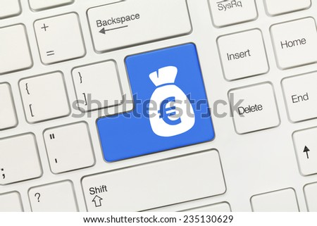 Close-up view on white conceptual keyboard - Bag of euros (blue key) - stock photo