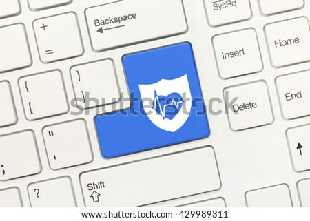Close-up view on white conceptual keyboard - Blue key with shield and health symbols - stock photo
