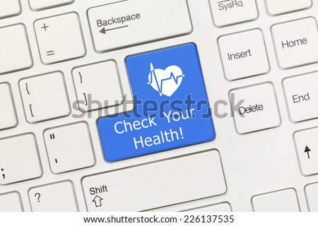 Close-up view on white conceptual keyboard - Check Your Health (blue key with heart symbol) - stock photo