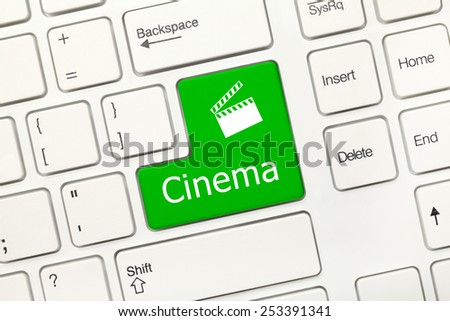 Close-up view on white conceptual keyboard - Cinema (green key) - stock photo