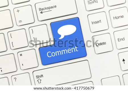 Close-up view on white conceptual keyboard - Comment (blue key with dialog box) - stock photo