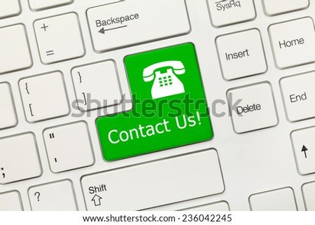 Close-up view on white conceptual keyboard - Contact Us (green key with phone sign) - stock photo