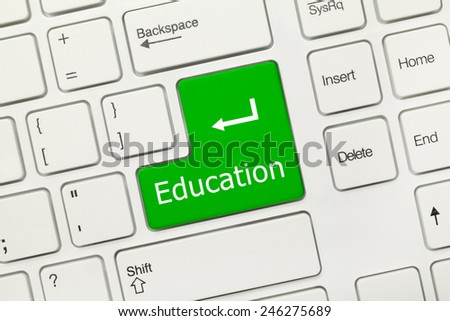 Close-up view on white conceptual keyboard - Education (green key) - stock photo