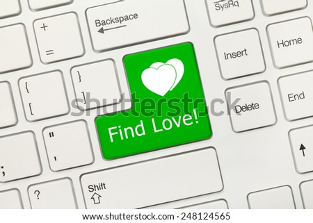 Close-up view on white conceptual keyboard - Find Love (green key) - stock photo