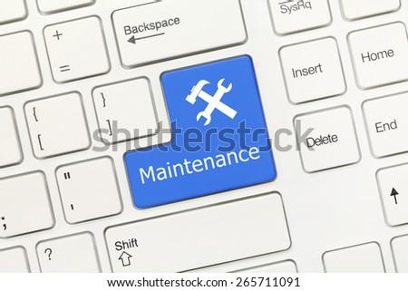 Close-up view on white conceptual keyboard - Maintenance (blue key) - stock photo