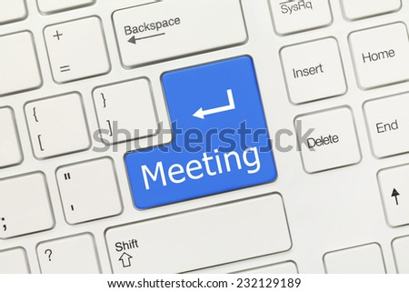 Close-up view on white conceptual keyboard - Meeting (blue key) - stock photo