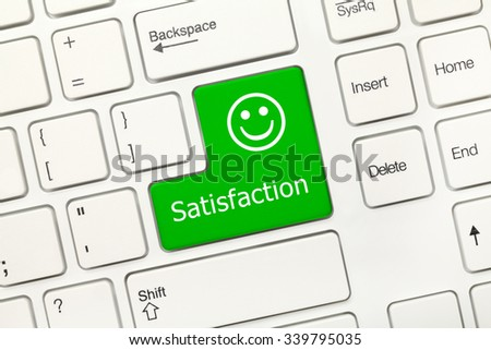 Close-up view on white conceptual keyboard - Satisfaction (green key) - stock photo