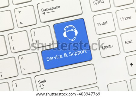 Close-up view on white conceptual keyboard - Service and Support (blue key with call-center operator) - stock photo