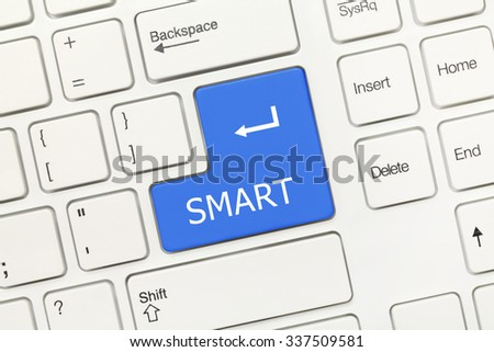 Close-up view on white conceptual keyboard - SMART (blue key) - stock photo