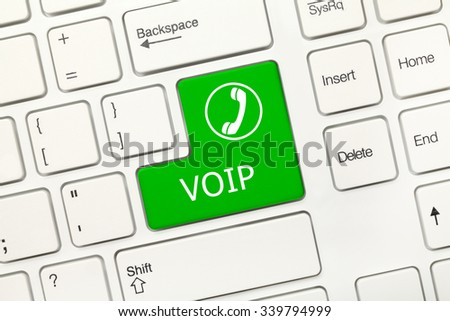 Close-up view on white conceptual keyboard - VOIP (green key) - stock photo