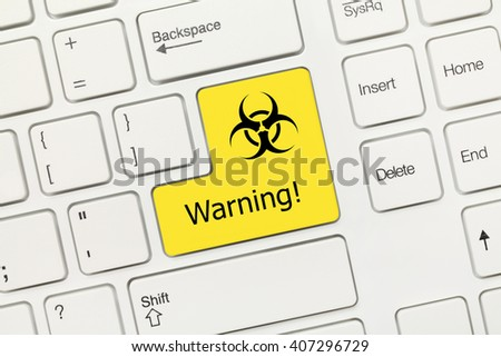 Close-up view on white conceptual keyboard - Warning (yellow key with biohazard symbol) - stock photo