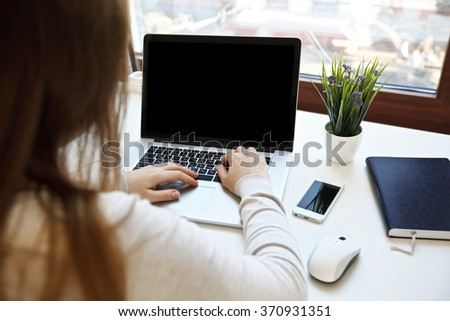 Close-up view on woman who working on laptop - stock photo