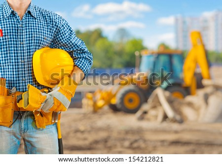 close up view on worker with tools - stock photo