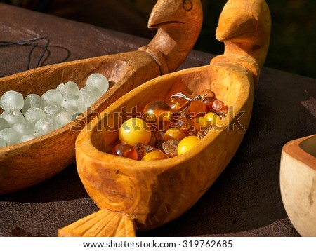 Close up view selection of Amber in a hand carved wooden tray     - stock photo