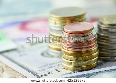 Close up view : stacks of coins in many colors i.e. silver, gold and copper. Various types and sizes of coins / currency, can be used as montage background, layer processing, editing, photo merge, etc - stock photo