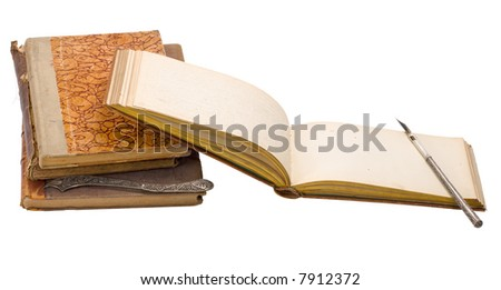 Close-up view to ancient album and some tools on white background